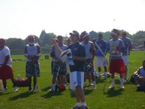 Mat Levine, founder of Citylax, draws the raffle as Connor Wilson(red shorts) and Shannon Sturz looks on