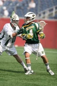 Greg Cerar (#4) of CW Post backs in a LeMoyne defender